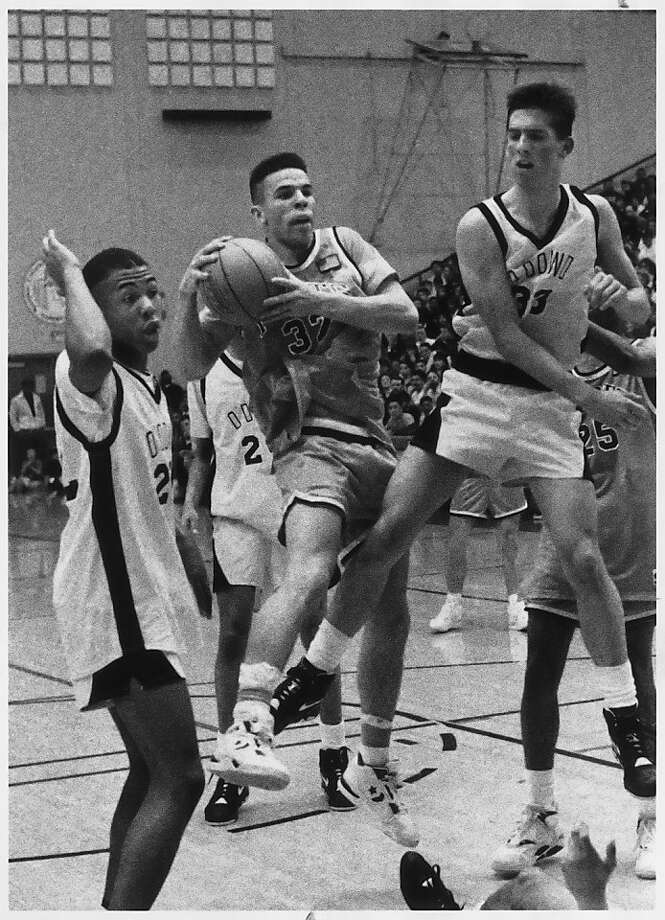 Jason Kidd, with ball, playing for St. Joseph of Alameda, between two unidentified Bishop O'Dowd players on Feb. 4, 1991, at Cal State Hayward's gym.  Photo was taken 2/4/91. Photo: John O'Hara, The Chronicle
