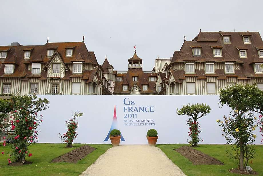 A picture shows a banner announcing the G8 summit in front of hotel Normandy in the French northwestern searesort of Deauville, on May 19, 2011. Fourteen thousand security forces are to cover the city during the G8 summit on May 26 and 27, 2011. Photo: Kenzo Tribouillard, AFP/Getty Images