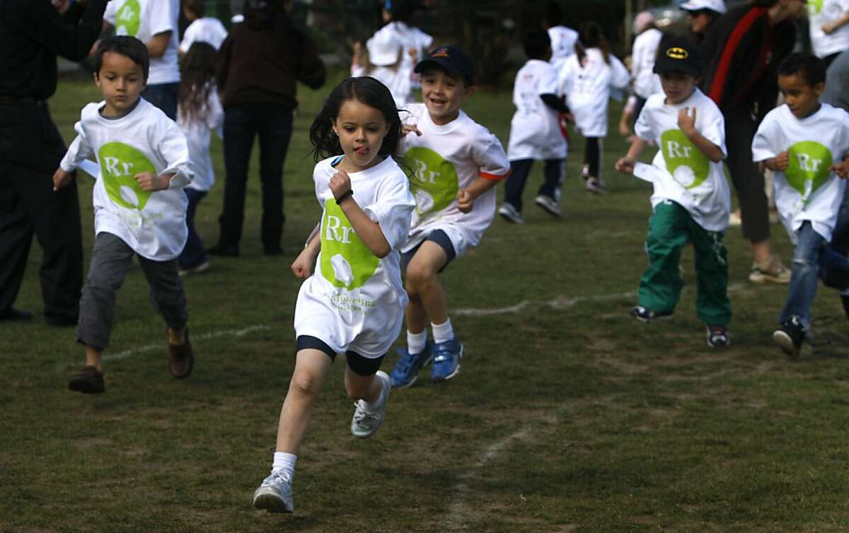 Kindergartners run around in circles at Coleman Elementary School to raise money for school libraries in San Rafael, Calif. on Friday, May 20, 2011. Students throughout the school district gathered pledges per lap run in the fundraising campaign.