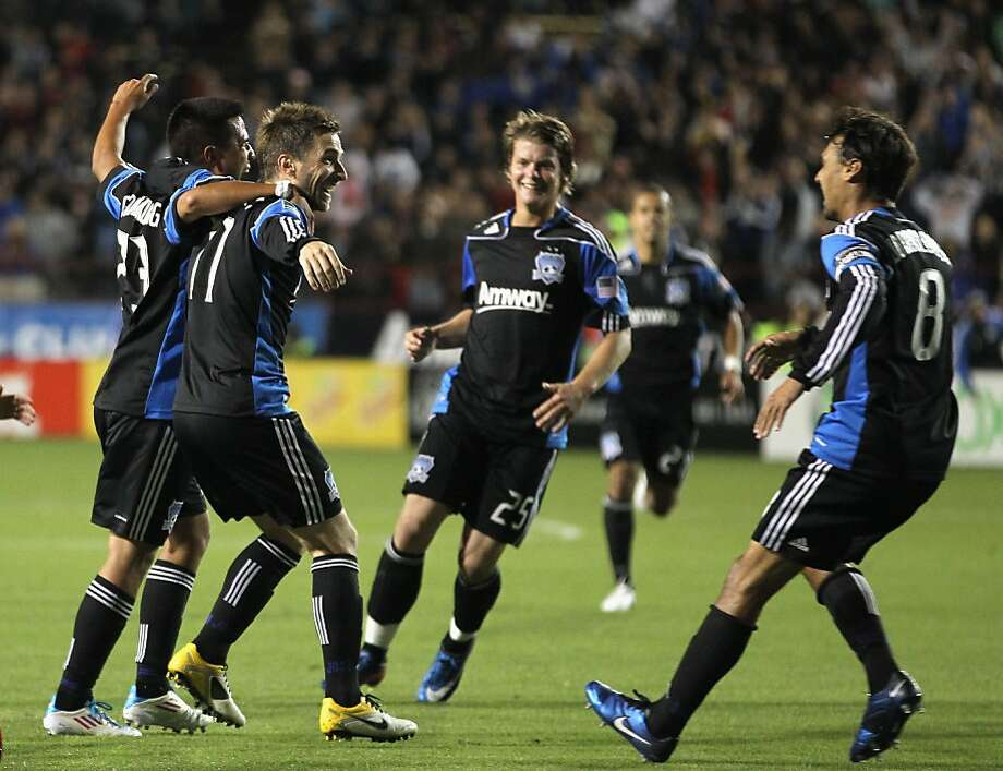 SANTA CLARA, CA - MAY 21:  Bobby Convey #11 of the San Jose Earthquakes is congratulated by teammates after he scored a goal against the New England Revolution at Buck Shaw Stadium on May 21, 2011 in Santa Clara, California. Photo: Ezra Shaw, Getty Images