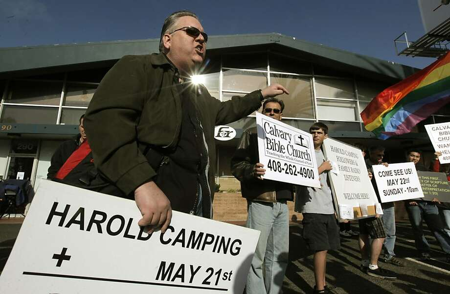 Deacon James Bynum of  Calvary Bible Church in Milpitas preaches a message of salvation to the large group gathered outside the headquarters of Family Radio in Oakland on Saturday. Photo: Michael Macor, The Chronicle