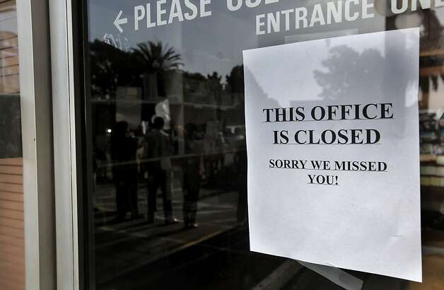A sign on the front door of the headquarters of Family Radio in Oakland on Saturday. Photo: Michael Macor, The Chronicle
