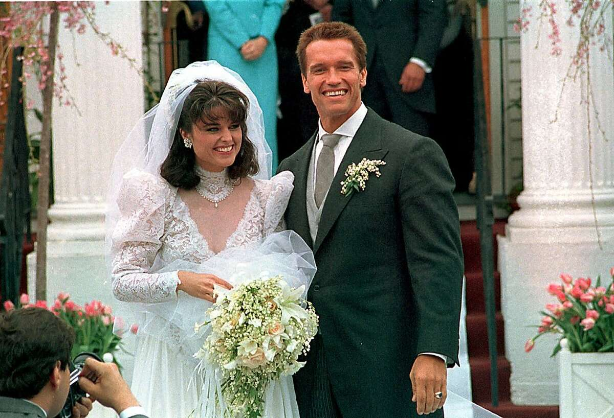 In an April 25, 1986 file photo Actor Arnold Schwarzenegger poses with his bride Maria Shriver following their wedding ceremony in Hyannis, Mass. Former California Gov. Arnold Schwarzenegger and his wife of 25 years, Maria Shriver, announced Monday May 9, 2011, that they are separating.
