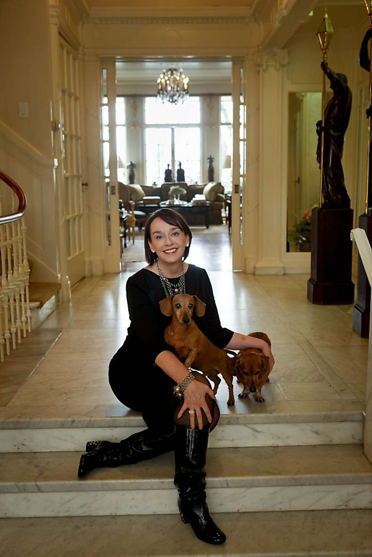 Elisa Stephens, President of the Academy of Art University, is seen her San Francisco, Calif., home with her dogs, Archie and Rudy, right, on Friday, April 22, 2011.