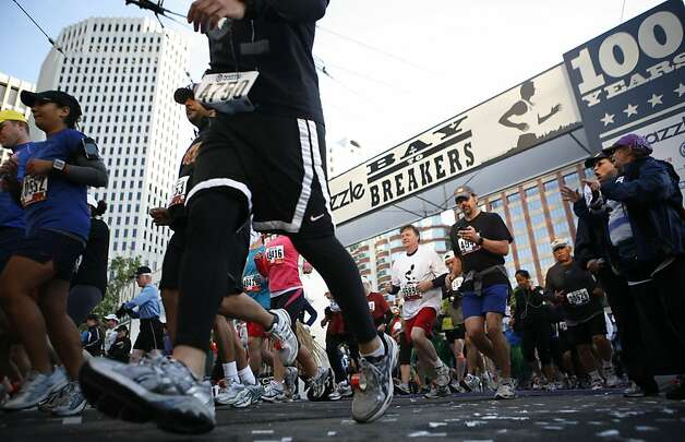Runners begin the race at 7 AM on Howard street. The 100th annual Bay To Breakers took place on Sunday, May 15, 2011. Photo: Anna Vignet, The Chronicle