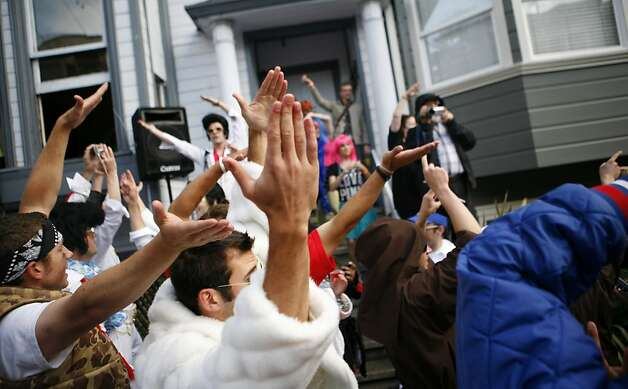 Participants in the race dance to YMCA from music blasting from a house on Hayes street. The 100th annual Bay To Breakers took place on Sunday, May 15, 2011. Photo: Anna Vignet, The Chronicle