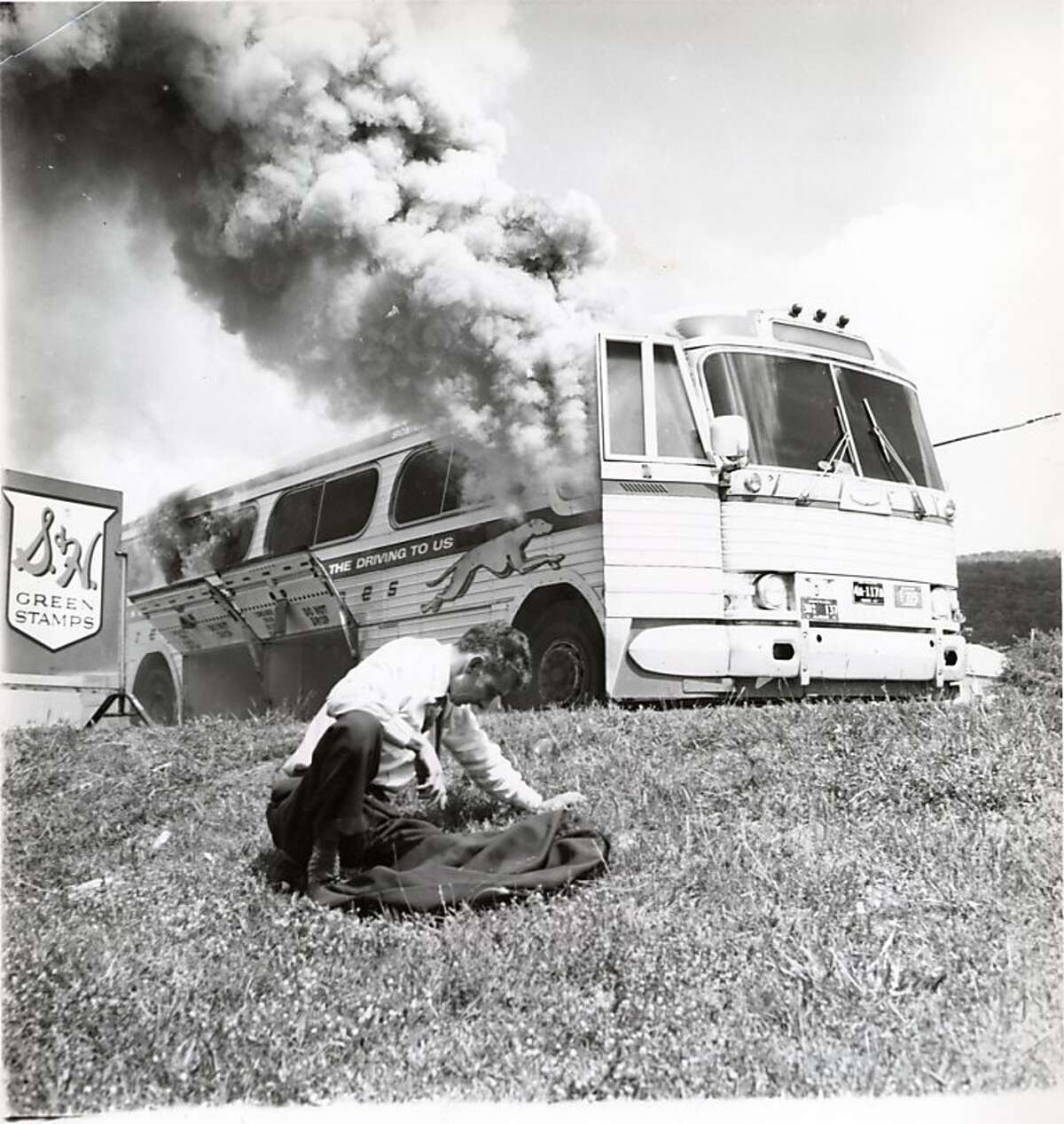 A Greyhound bus that had carried Freedom Riders, was set afire by Ku Klux Klan members outside Anniston, Ala., on May 14, 1961. Bleiberg story. Photograph by Joseph Postiglione Courtesy Birmingham Civil Rights Institute