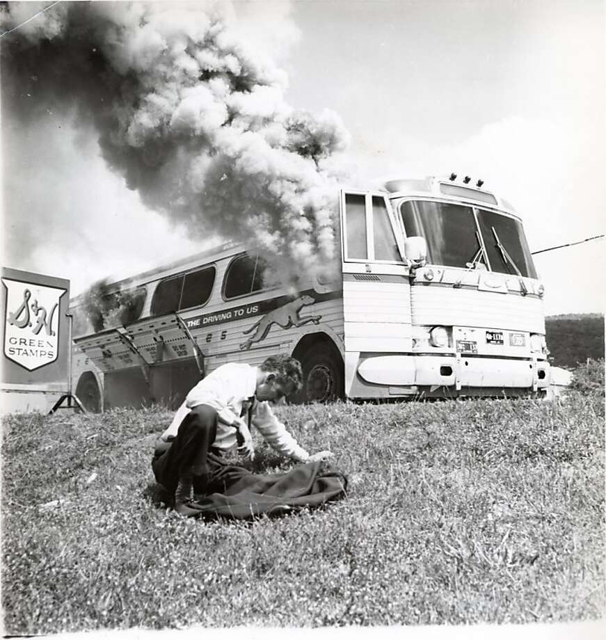 A Greyhound bus that had carried Freedom Riders, was set afire by Ku Klux Klan members outside Anniston, Ala., on May 14, 1961. Bleiberg story. Photograph by Joseph Postiglione Courtesy Birmingham Civil Rights Institute Photo: Joseph Postiglione, Birmingham Civil Rights Inst.