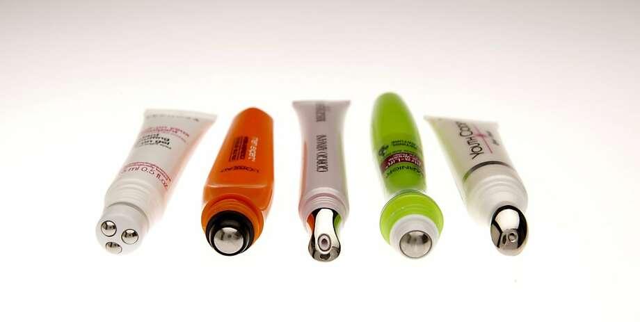 (Left to Right)  Instant depuffing roll-on gel ($15, Sephora).  Hydra-Energetic Ice Cold Eye Roller by L'Oreal ($10.99, www.drugstore.com).   Regenessence [3.R] eye rejuvenating serum ($75, www.giorgioarmanibeauty-usa.com).   Ultra-lift Anti-wrinkle Eye Roller by Garnier Nutritioniste ($18.99, Walgreens).  Youth Code Rejuvenating Eye Cream by L'Oreal ($24.99, www.drugstrore.com). Photo: Russell Yip, The Chronicle