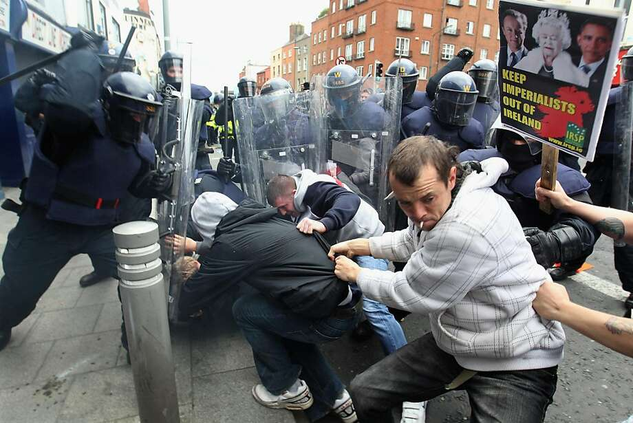 DUBLIN, IRELAND - MAY 17:  Police and protesters clash in the streets adjacent to the Garden on Remembrance where Queen Elizabeth II laid a wreath on May 17, 2011 in Dublin, Ireland. The Duke and Queen's visit is the first by a monarch since 1911. An unprecedented security operation is taking place with much of the centre of Dublin turning into a car free zone. Republican dissident groups have made it clear they are intent on disrupting proceedings. Photo: Oli Scarff, Getty Images