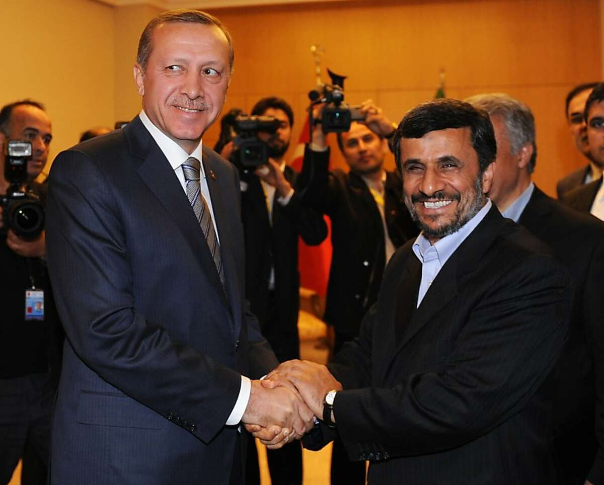 """Iranian President Mahmoud Ahmadinejad (R) shakes hand with Turkish Prime Minister Recep Tayyip Erdogan before their meeting during the fourth United Nations Conference on the Least Developed Countries in Istanbul on May 9, 2011. Ahmadinejad on Monday blamed poverty in the world's least developed countries (LDCs) on the """"colonial policies"""" of leading powers and on an unfair international economic system."""