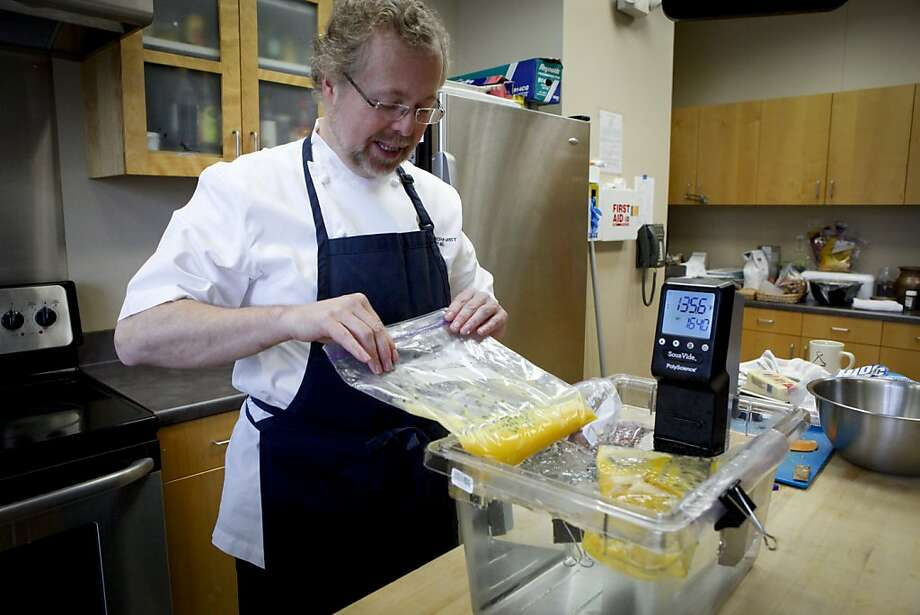 """Nathan Myhrvold, Microsoft's former chief technology officer, has self-published a six volume cookbook, """"Modernist Cuisine,"""" which weighs thirty-nine pounds and retails for $625.  He shares some of his techniques and philosophies as he cooks breakfast in the Chronicle test kitchen on Tuesday, April 19, 2011 in San Francisco, Calif., and talks about his cookbook. Photo: Russell Yip, The Chronicle"""