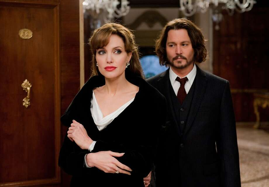"""Angelina Jolie as """"Elise"""" and Johnny Depp as """"Frank"""" in Columbia Pictures' THE TOURIST. Photo: Peter Mountain, Sony Pictures"""