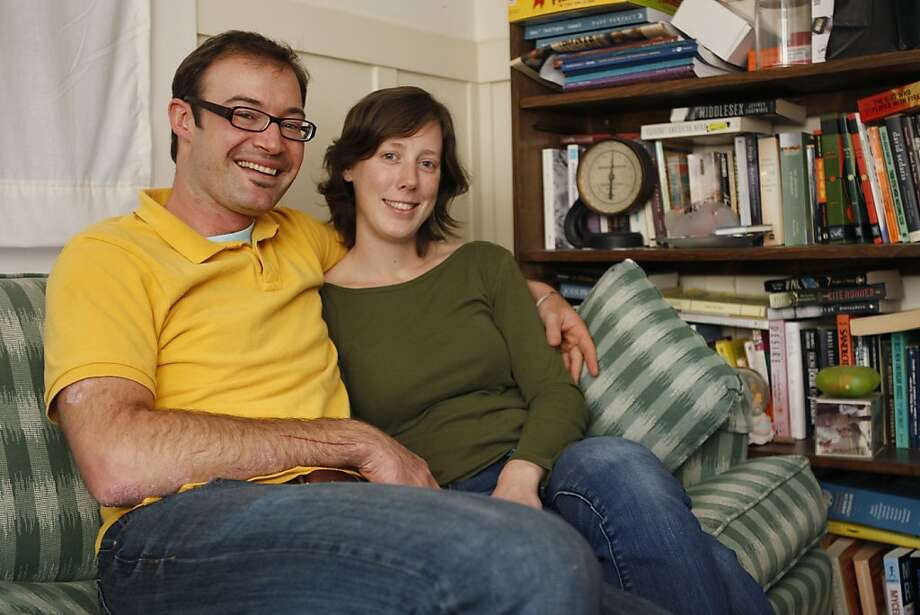 Sam Hoffman and Katy Wafle sit on the couch in the living room of their Oakland Calif, home on Tuesday, May 10, 2011. The couple has been married five years and Hoffman began raising rabbits for food approximately a year ago. Photo: Alex Washburn, The Chronicle
