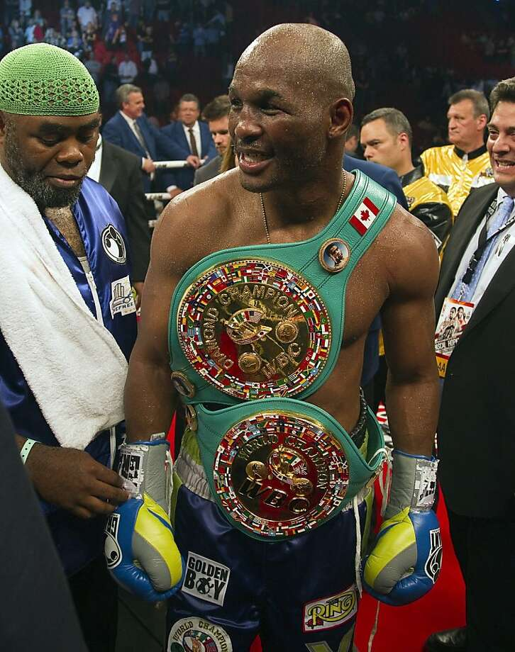 Bernard Hopkins, from Philadelphia, celebrates after defeating Jean Pascal, from Montreal, with a unanimous decision to win the  WBC light heavyweight world title fight Saturday, May 21, 2011  in Montreal. The 46-year-old Hopkins (52-5-2) is the oldest fighter to take a major world belt since Geroge Foreman took the heavyweight title with a victory over Michael Moorer in 1994. Photo: Ryan Remiorz, AP
