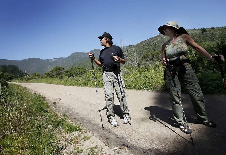 Local residents Kathy (right) and Michael Rain look back at the Montara Mountains and the Rancho Corral de Tierra they love to hike. The 4,262 acre Rancho Corral de Tierra, the largest undeveloped tract of land remaining on the San Mateo coast, is about to be added to the Golden Gate National Recreation Area. Photo: Brant Ward, The Chronicle