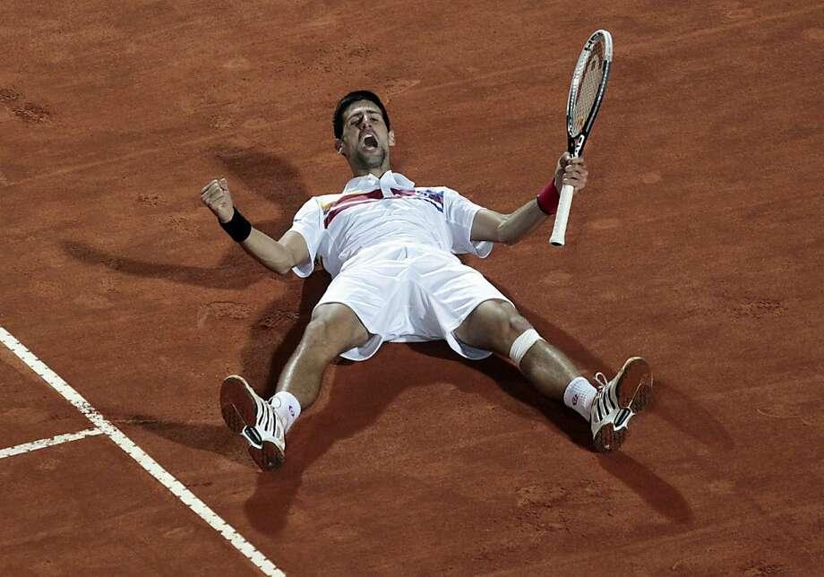 Serbia's Novak Djokovic celebrates at the end of the final match against SPain's Rafael Nadal at the Italian Open tennis tournament in Rome, Sunday, May 15, 2011. Djokovic won 6-4, 6-4. Photo: Gregorio Borgia, AP