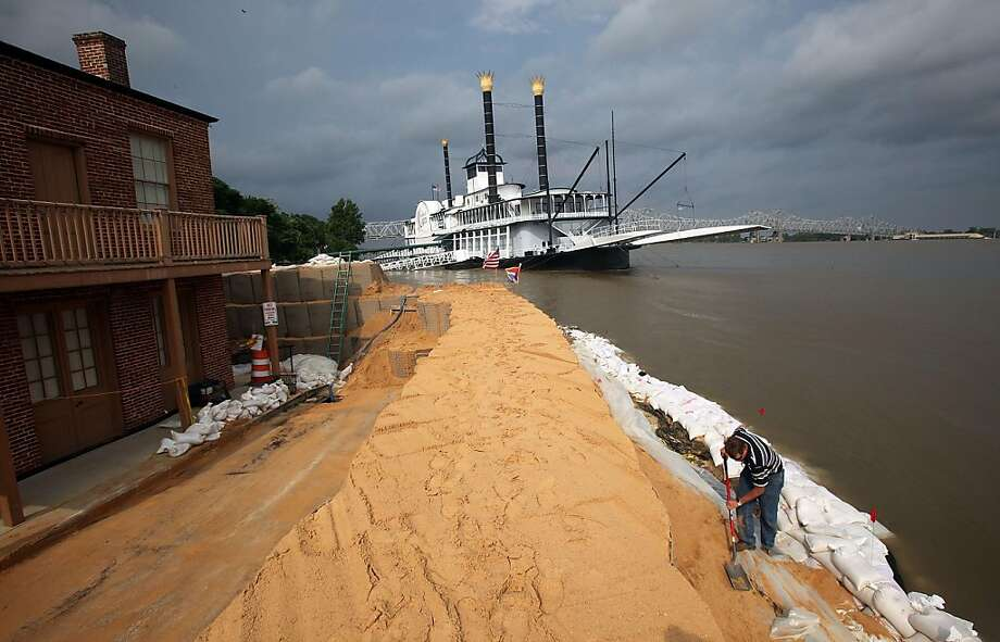 NATCHEZ, MS - MAY 20:  City surveyor Tony Moon works on a makeshift levee on the edge of the flooding Mississippi River with the temporarily shuttered Isle of Capri riverboat casino behind him on May 20, 2011 in Natchez, Mississippi. The river is forecastto crest at 62.1 feet tomorrow, the highest level in Natchez recorded history. Natchez is the oldest continuous settlement on the Mississippi River. Heavy rains have left the ground saturated, rivers swollen, and have caused widespread flooding in Louisiana. Mississippi, Missouri, Illinois, Kentucky, Tennessee, and Arkansas. Photo: Mario Tama, Getty Images