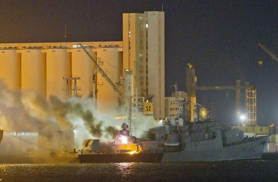 **ADDS INFORMATION IN SHIP & EXPANDS CAPTION**Smoke and flames pour from the Libyan Navy frigate Al Ghardabia, after it was hit during an airstrike by Tornado bombers of Britain's Royal Force on the port area of Tripoli, in the early hours of Friday May 20, 2011. NATO confirmed that its warplanes targeted the vessels and accused Libya of using its ships in the escalating conflict, including attempts to mine the harbor in Misrata. Rebels trying to end the nearly 40-year rule of Libyan leader Moammar Gadhafi have been struggling to hold the Western city of Misrata against repeated attacks by forces loyal to Gadhafi(AP Photo/Darko Bandic) Photo: Darko Bandic, AP