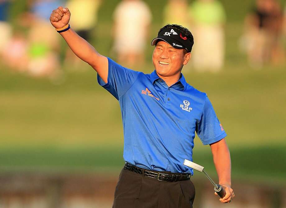 PONTE VEDRA BEACH, FL - MAY 15:  K.J. Choi of South Korea celebrates making a par-saving putt to defeat David Toms on the first playoff hole during the final round of THE PLAYERS Championship held at THE PLAYERS Stadium course at TPC Sawgrass on May 15, 2011 in Ponte Vedra Beach, Florida. Photo: Streeter Lecka, Getty Images