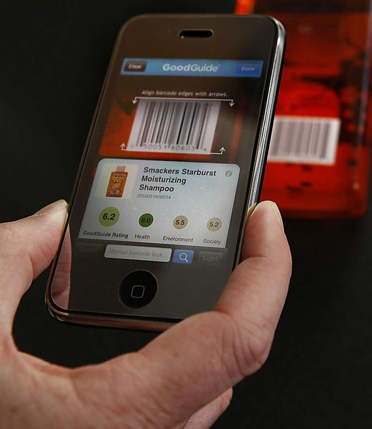Founder Dara O'Rourke of GoodGuide, a resource for consumers looking to buy safe, environmentally good products showing how to scan a barcode at his office in San Francisco, Calif., on Tuesday, May 10, 2011. GoodGuide's iPhone app scans barcodes and looks up the product in its database.