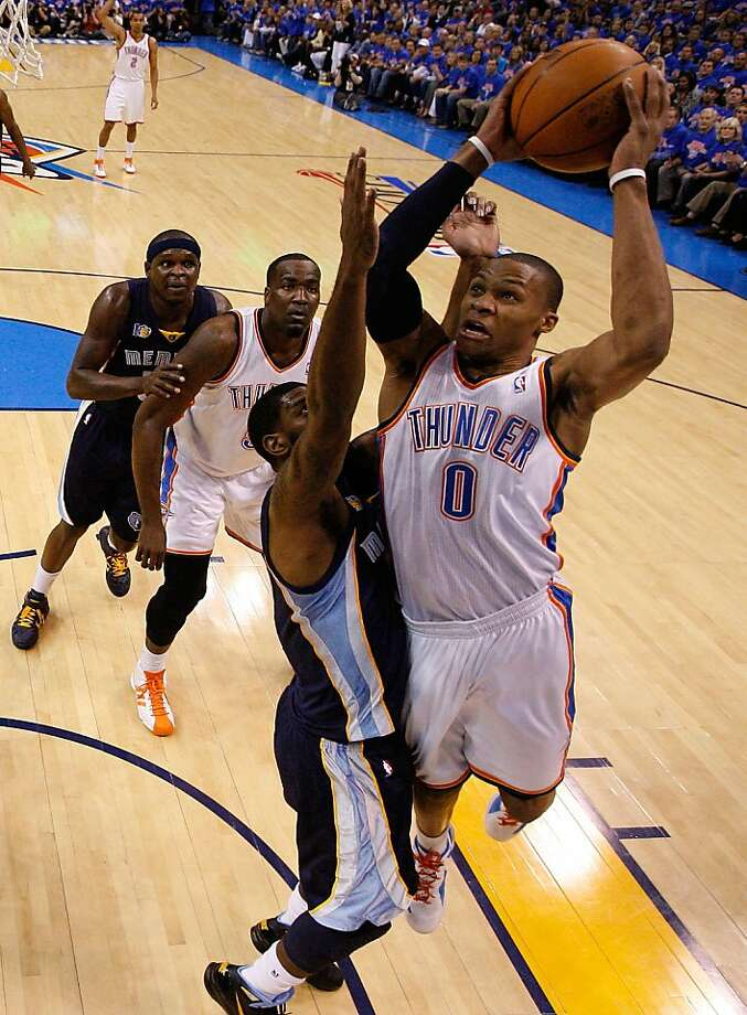 OKLAHOMA CITY, OK - MAY 15:  Guard Russell Westbrook #0 of the Oklahoma City Thunder takes a shot against O.J. Mayo #33 of the Memphis Grizzlies in Game Seven of the Western Conference Semifinals in the 2011 NBA Playoffs on May 15, 2011 at Oklahoma City Arena in Oklahoma City, Oklahoma.  NOTE TO USER: User expressly acknowledges and agrees that, by downloading and or using this photograph, User is consenting to the terms and conditions of the Getty Images License Agreement. Photo: Ronald Martinez, Getty Images