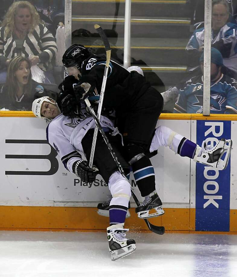 Jason Demers (right) checks Ryan Smyth into the boards in the third period of the San Jose Sharks game against the Los Angeles Kings in Game 1 of the NHL Western Conference quarterfinals in San Jose, Calif. on Thursday, April 14, 2011. Photo: Paul Chinn, The Chronicle