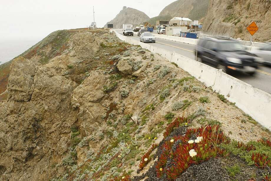 Cars rush through the Devil's Slide Area of highway 1 on Thursday, May 19, 2011. This area is one of 57,000 locations in California that is susceptible to landslides. Photo: Alex Washburn, The Chronicle