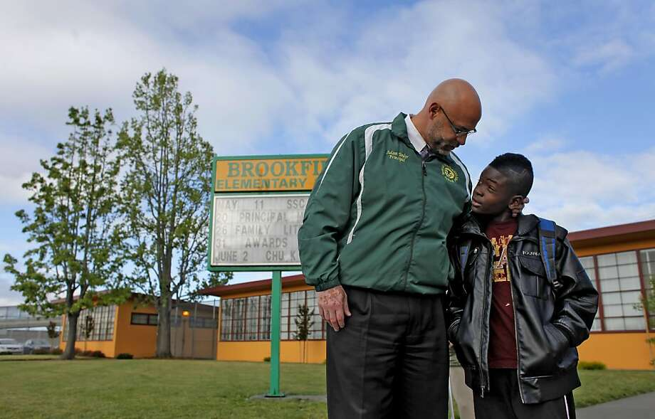 Principal Adam Taylor says good morning to third grader Sky Hogue when he comes to school, Wednesday May 18, 2011, at the Brookfield Elementary School in Oakland, Calif. Taylor said the greatest compliment he ever received was when a parent praised him for making sure he touched the head of every child every day. Photo: Lacy Atkins, The Chronicle