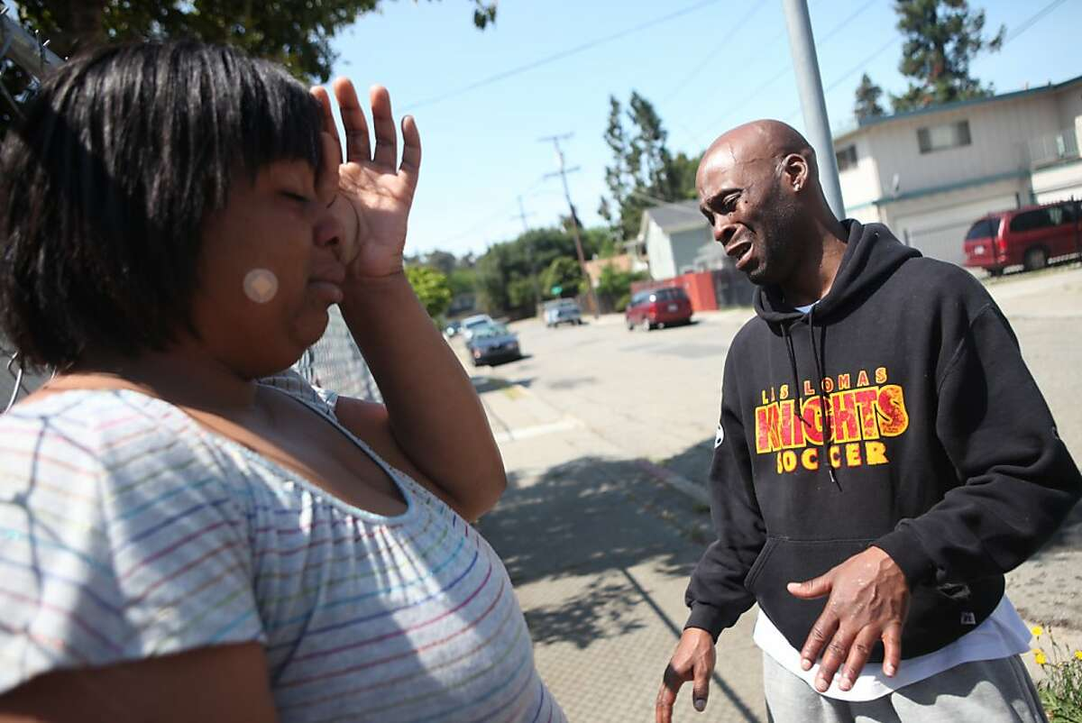 Robin Cobb of Sacramento, sister of Fletcher Antoine Jackson who was killed in an officer involved shooting, reacts as she stands with her cousin Deandro Long on Curran Avenue in Oakland, Calif., Thursday, May 19, 2011. On Wednesday evening, officers reportedly shot two suspects at around 10:30 p.m. in the 3000 block of Curran Avenue in Oakland, Calif.