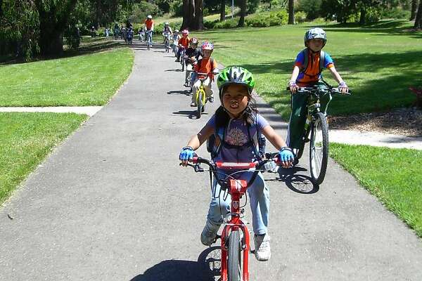 Participants in the Wheel Kids camp learning bicycling skills and safety while exploring the Bay Area.