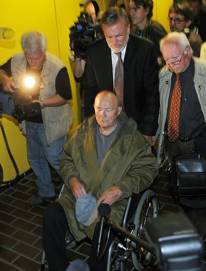 John Demjanjuk leaves the court after his verdict on May 12, 2011 in Munich, southern Germany. Convicted Nazi guard John Demjanjuk will be freed because of his age, because he cannot travel and pending a possible appeal, a court in Munich said. Earlier, the same court convicted Demjanjuk, 91, of helping to kill almost 30,000 people while a guard at the Sobibor death camp in World War II, sentencing him to five years in prison. Photo: Christof Stache, AFP/Getty Images