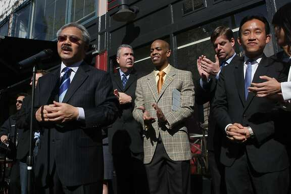 San Francisco mayor Ed Lee (left) makes an announcement of new tenants in the central Market St. area on Market at Taylor streets in San Francisco, Calif. on Wednesday, April 6, 2011.  Left to right--mayor Ed Lee, supervisor Mark Farrell, deputy chief of state Paul Henderson, board president David Chiu, supervisor Jane Kim.