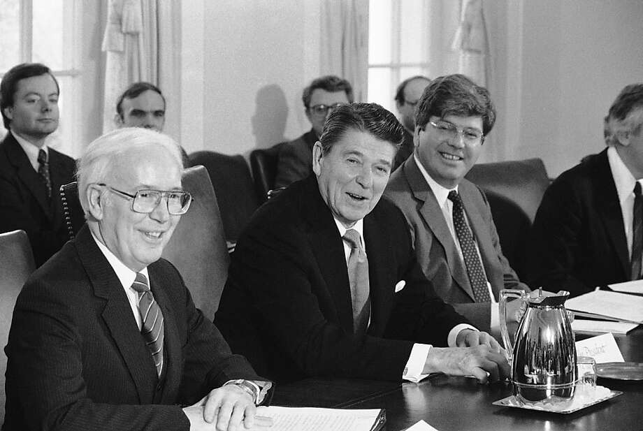 President Ronald Reagan is flanked by Education Secretary Terrel Bell, left, White House Policy director, during a meeting in the Cabinet Room in Washington, Feb. 23, 1984 where they discussed school discipline. (AP Photo) Photo: Anonymous, AP