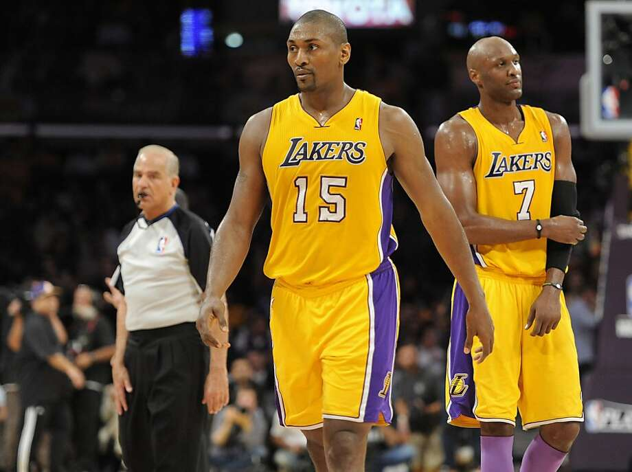 """In  this photo made Wednesday, May 4, 2011, Los Angeles Lakers' Ron Artest, center, walks off the court after being ejected in the second half in Game 2 of a second-round NBA playoff basketball series against the Dallas Mavericks, in Los Angeles. At rightis the Lakers' Lamar Odom.  Artest was ejected with 24.4 seconds left for clotheslining Dallas guard J.J. Barea, possibly leading to a suspension. Even Lakers coach Phil Jackson conceded """"there's a good chance"""" he won't have Artest on Friday. Photo: Chris Pizzello, AP"""