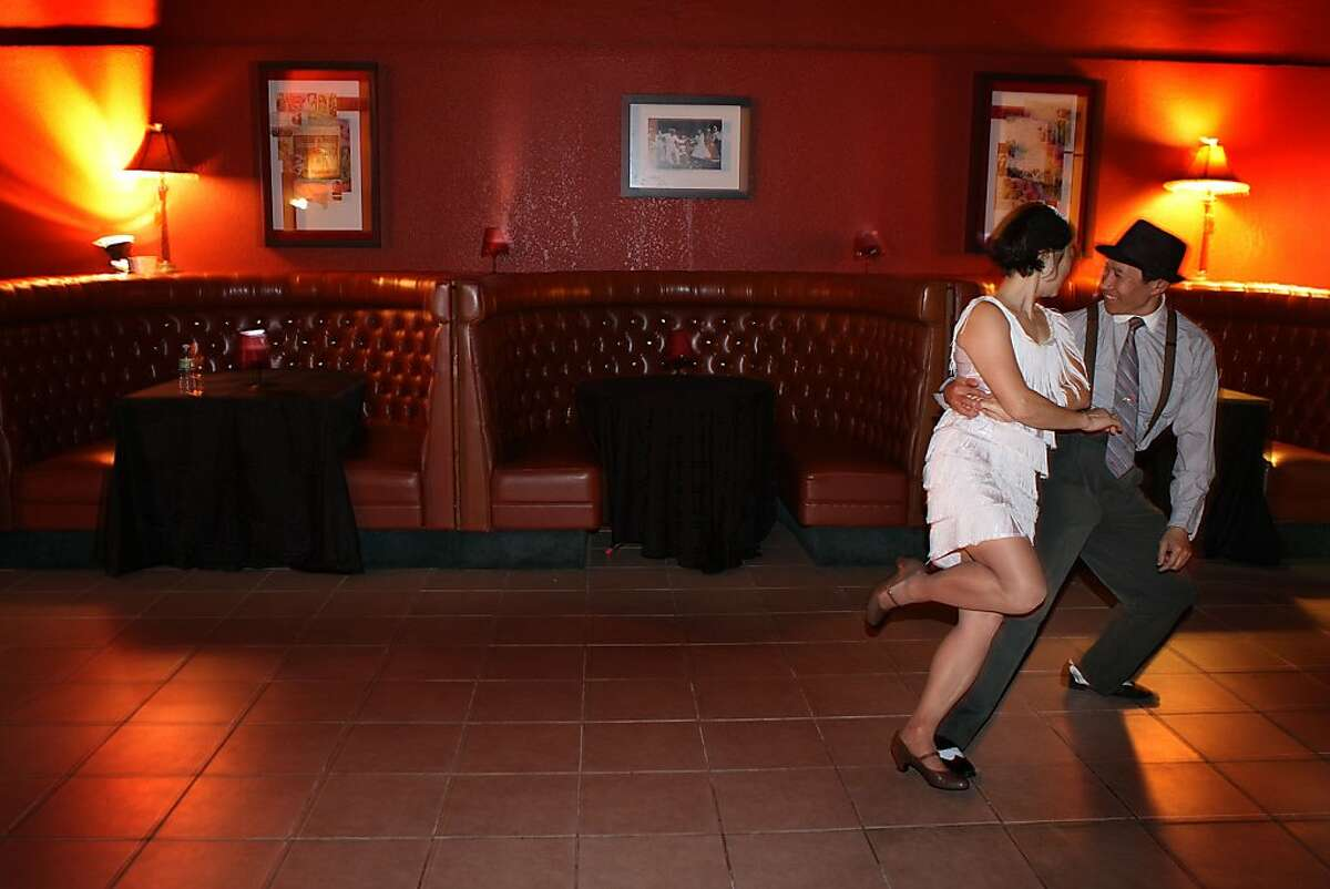 Alan Lau and his wife Linda Lau from San Francisco have the last dance at Old Skool Cafe in San Francisco, Calif., on Friday, April 22, 2011. Old Skool Cafe is a program for youth that teaches them marketable culinary skills.