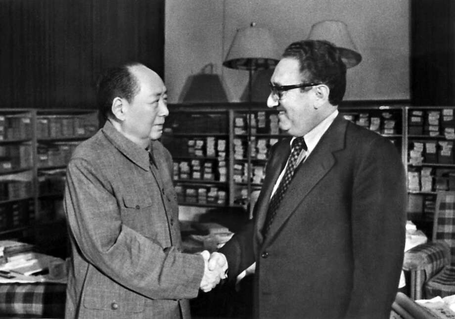 BEIJING, CHINA - NOVEMBER 24, 1973: US Secretary of State Henry Kissinger (4th R) meets with Chinese president Mao Zedong (4th L), 24 November 1973 in Beijing, China. Photo: AFP/Getty Images