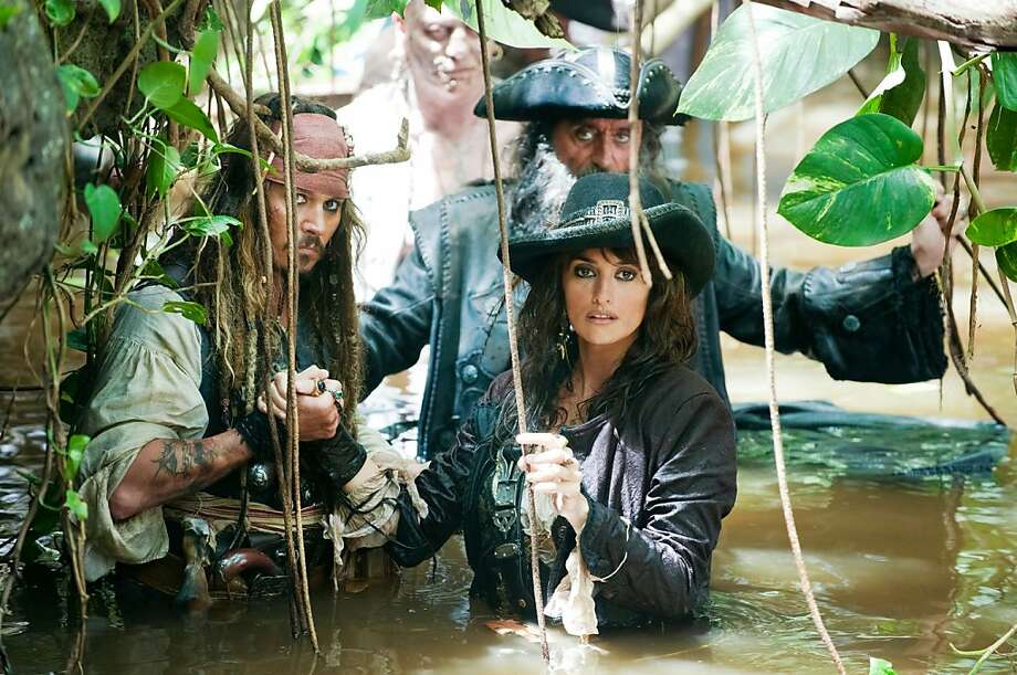 "In this film publicity image released by Disney, Johnny Depp, left,  Penelope Cruz, right, and Ian McShane, background are shown in a scene from, ""Pirates of the Caribbean: On Stranger Tides."" Photo: Peter Mountain, AP"
