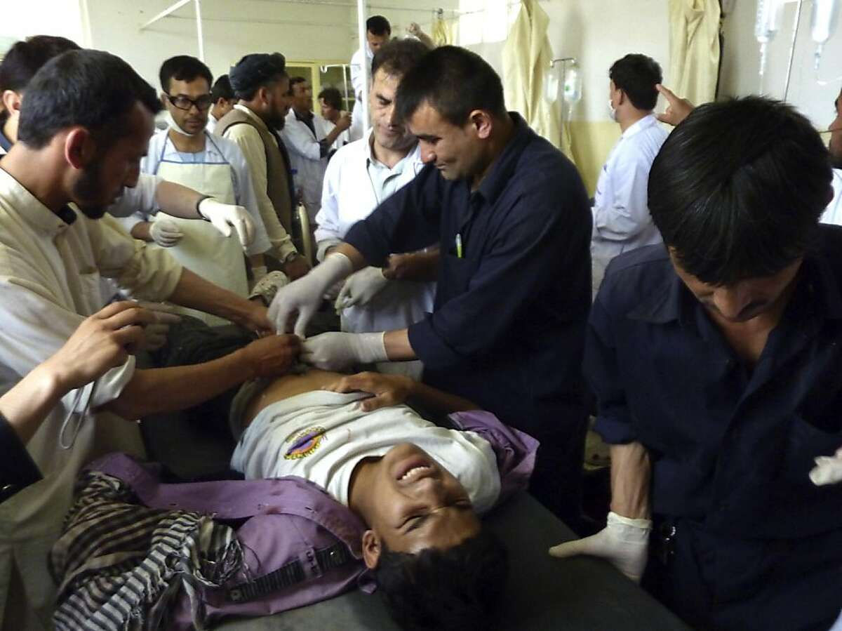 A wounded Afghan man receives treatment at a hospital after a protest against NATO-led forces in an overnight raid in Taloqan, capital of the usually peaceful northeastern province of Takhar on May 18, 2011. Eleven people were killed and over 50 others injured in Afghanistan on May 18, including two German troops, in protests over the deaths of four people in a NATO raid, officials said.