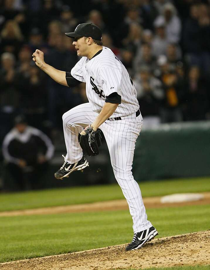 Chciago White Sox' pitcher Jake Peavy delivers to the last Cleveland Indians batter while throwing a complete baseball game three-hitter to win 1-0 on Wednesday, May 18, 2011. Photo: Charles Cherney, AP