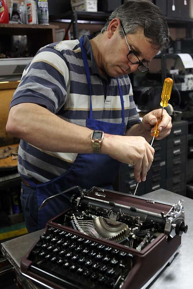 John Sansone, owner of Los Altos Business Machines,  repairs a 1953 Olympia portable typewriter in his downtown Los Altos, CA shop on Thursday, May 5, 2011. Photo: Erin Lubin, Special To The Chronicle