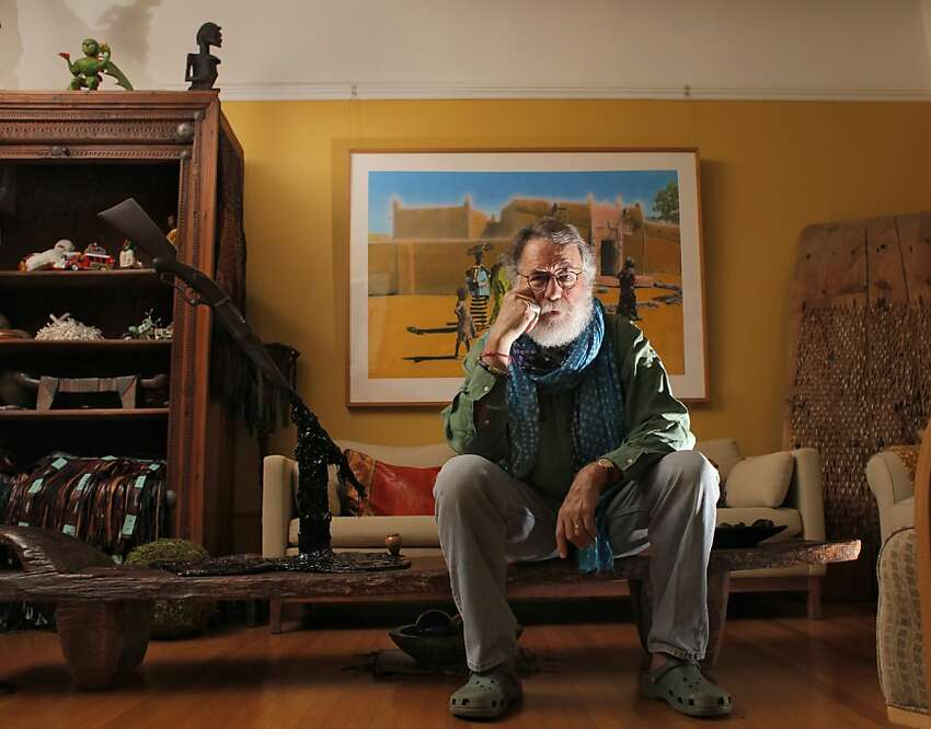 Tom Seligman sits among his African art, Sunday April 17, 2011, at his home in San Francisco, Calif. He is retiring at the end of the year as director of the Cantor Arts Center to work on other projects and continue teaching at Stanford.