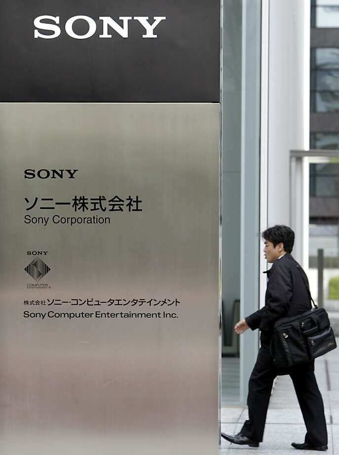 FILE - In this March 10, 2011 file photo, a man heads to the headquarters of Sony Corp. in Tokyo. Sony said on Monday May 2, 2011 that hackers may have taken personal information from an additional 24.6 million user accounts after a review of the recent PlayStation Network breach found an intrusion at a division that makes multiplayer online games. Photo: Koji Sasahara, AP