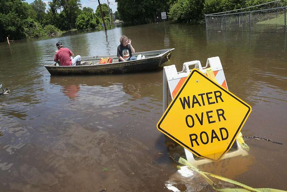 VICKSBURG, MS - MAY 17:  Guy Creekmore (L) and his wife Diane return from checking on their flooded home in the Chickasaw neighborhood May 17, 2011 in Vicksburg, Mississippi. The Mississippi river at Vicksburg is expected to crest May 19. Heavy rains haveleft the ground saturated, rivers swollen, and have caused widespread flooding along the Mississippi River from Illinois to Louisiana. Photo: Scott Olson, Getty Images