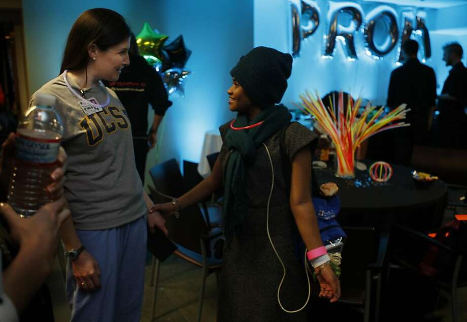Afrra Alanazi talks to nurse Maura O'Day while they enjoy themselves at the first UCSF Benioff Children's Hospital prom in San Francisco Calif, on Friday, April 15, 2011. Photo: Alex Washburn, The Chronicle