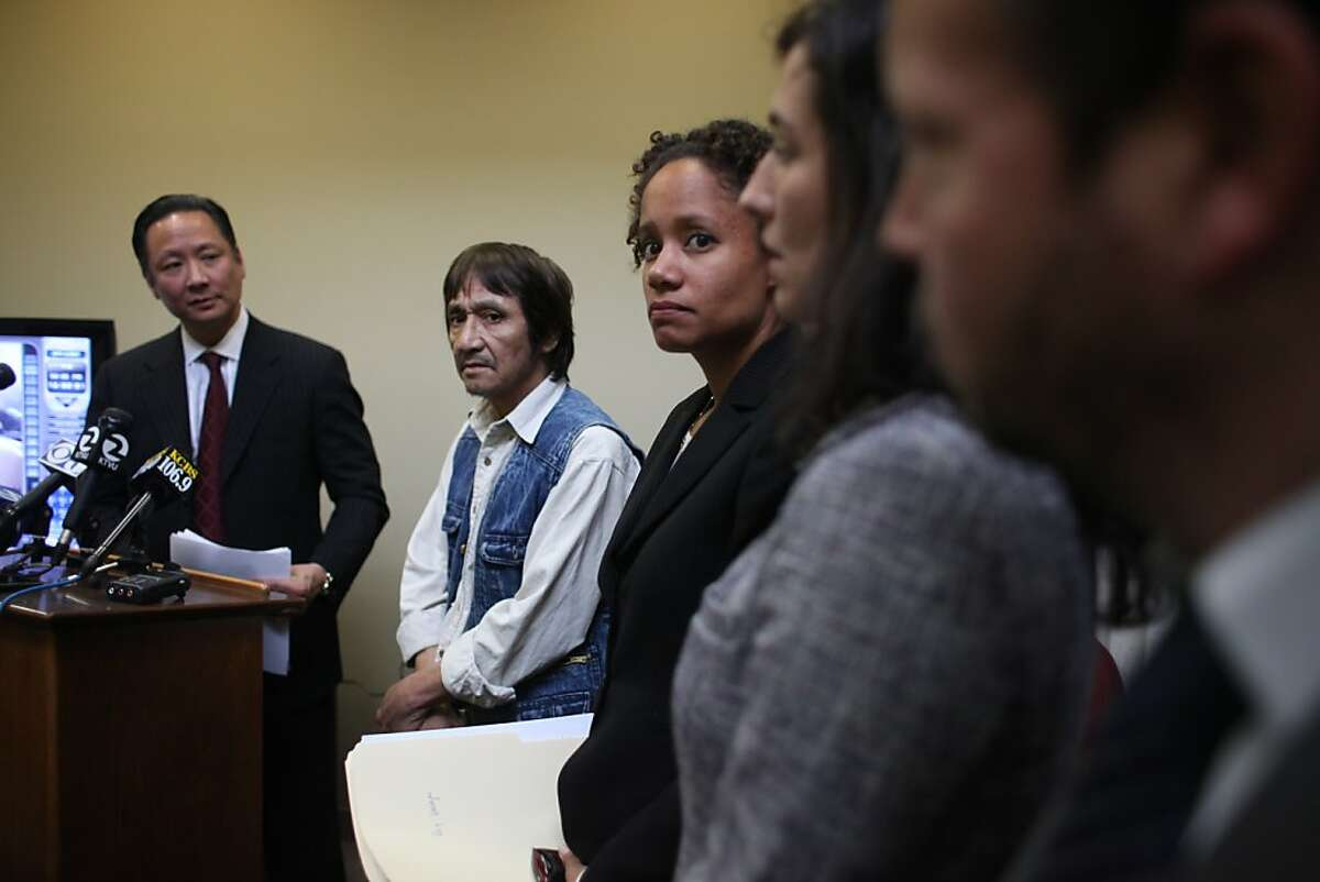 San Francisco Public Defender Jeff Adachi (left) speaks during a press conference at the Public Defender's Office as Jesus