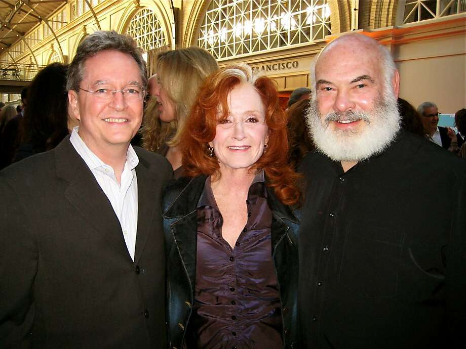 EWG founder-president Ken Cook (left) with Bonnie Raitt and Dr. Andrew Weil in the Ferry Building at the Earth Dinner. May 2011. By Catherine Bigelow. Photo: Catherine Bigelow, Special To The Chronicle