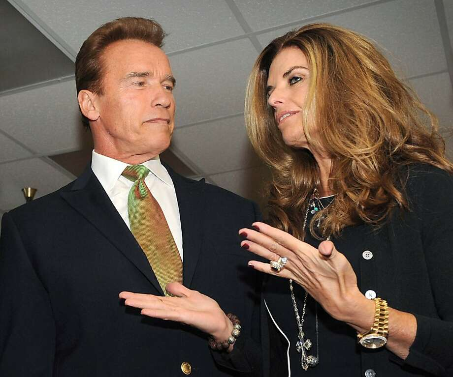 "(FILES) In this filed photo dated October 2, 2009 shows former California Governor Arnold Schwarzenegger and his wife Maria Shriver during a photo call at the Governors' Global Climate Summit in Los Angeles.  Movie megastar turned politician Arnold Schwarzenegger and his wife Maria Shriver have separated, they said in a statement to the Los Angeles Times late May 9, 2011.  The former California governor and Shriver -- a member of the Kennedy political dynasty -- have been living apart for a number of weeks, while they ""work on the future"" of their 25-year marriage, they said. Photo: Mark Ralston, AFP/Getty Images"