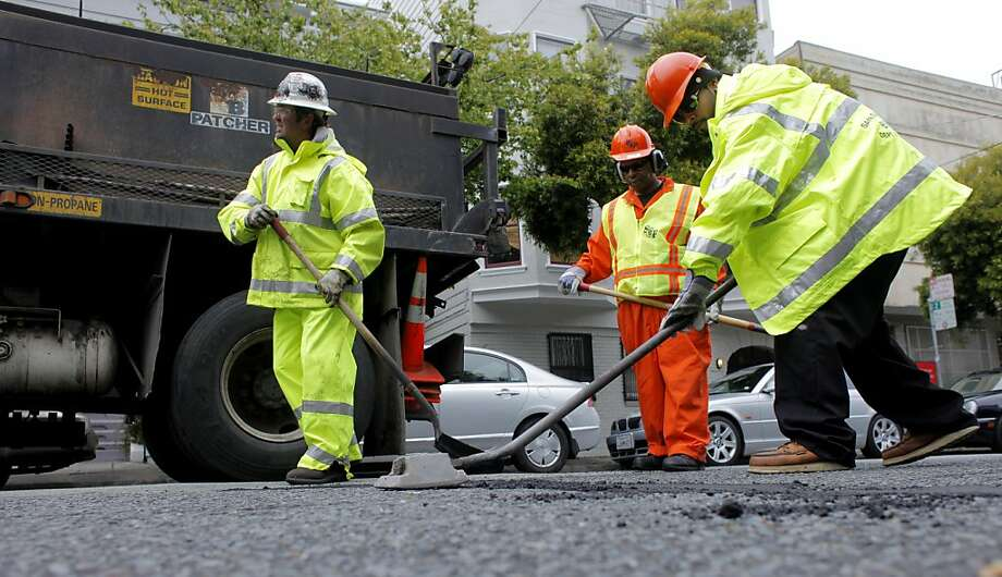 Crew members of the San Francisco Department of Public Works, Sean Healy, left, and Charles Bridgewater and Chris Solorzano fill potholes down Grove Street, Monday May 17, 2011, in San Francisco, Calif. San Francisco Mayor Ed Lee and several supervisors set to announce Tuesday their support of a proposed $248 million bond for the November ballot to fund street improvement. Photo: Lacy Atkins, The Chronicle