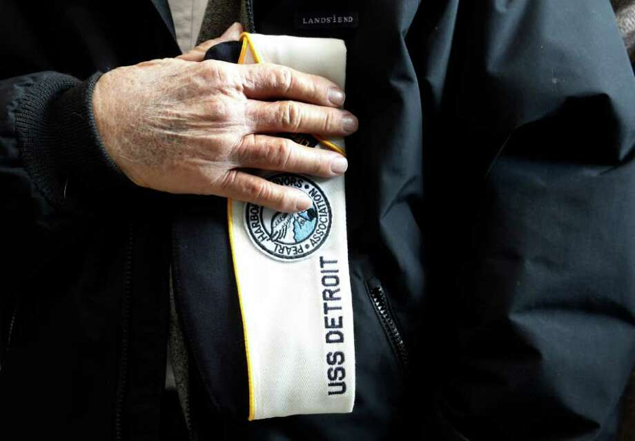 Pearl Harbor survivor John DiBetta holds his hat to his heart during a ceremony observing the 70th anniversary of the attack on Pearl Harbor, at the National World War II Museum in New Orleans, Wednesday, Dec. 7, 2011. Photo: Gerald Herbert, Associated Press / AP